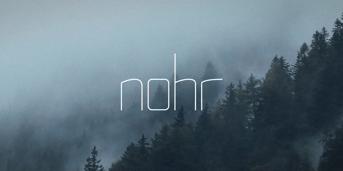 Final Norh logo on mountain/forest background.